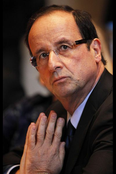Francois-hollande-president-of-the-general-council-of-correze-and-socialist-party-member-reacts-during-a-session-for-his-reelection-at-the-general-council-of-correze-in-tulle-1_947367